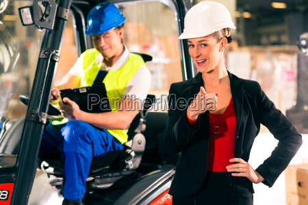 forklift driver and colleague in warehouse