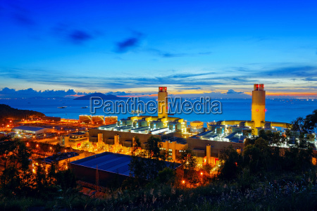 oil and water refinery at twilight