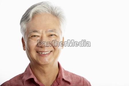 studio shot of kinesisk senior man