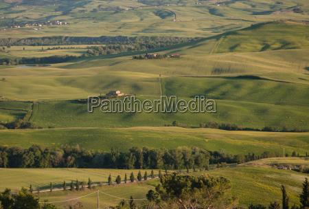 farmland in tuscan landscape at sunset