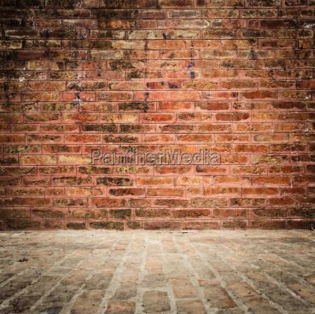 pared de ladrillo y suelo con