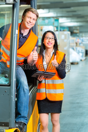 forklift driver and colleague in the