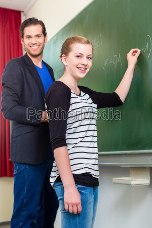 teacher asks student in math lesson