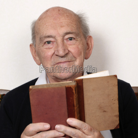 grandfather reading fairy tales from a