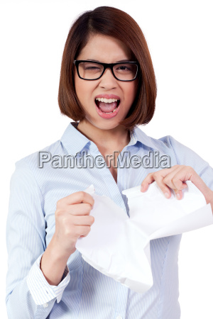 young desperate businesswoman with crumpled paper