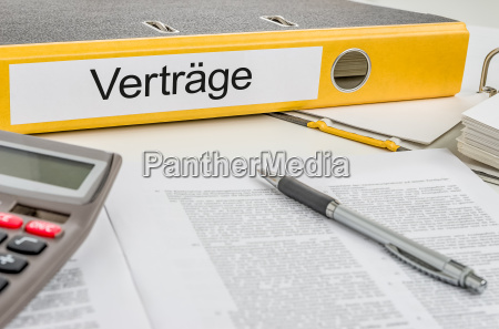 file folder labeled contracts