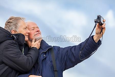 fotografere aeldre voksne par aeldre glad