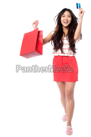 lets go shopping cheerful young girl