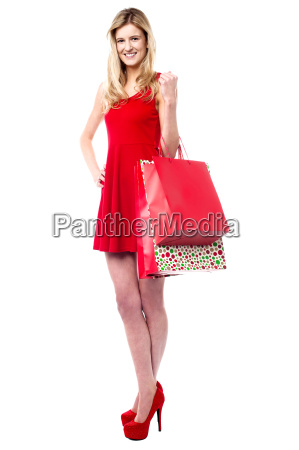 fashionable teen girl holding shopping bags