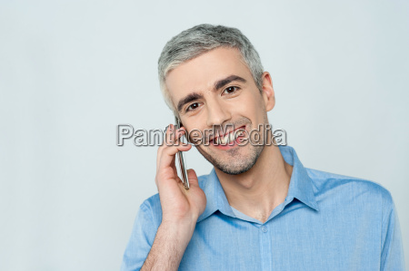 middle aged man talking on cell