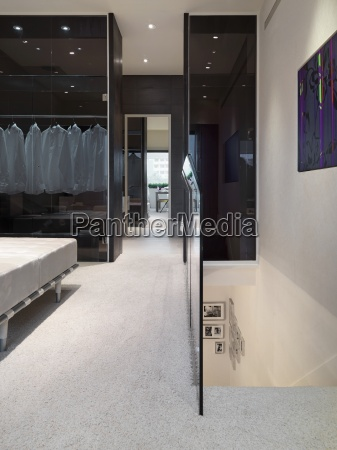 carpeted hallway and top of staircase