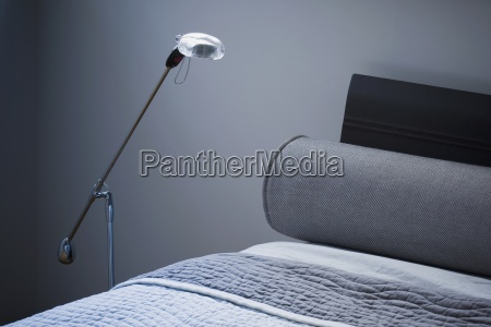 detail modern floor lamp beside bed