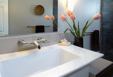 white modern bathroom sink with pink