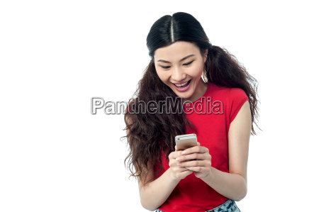 pretty chinese girl reading funny message