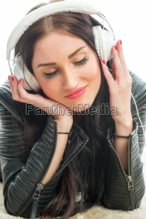 racial woman with headset enjoys music