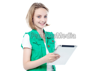 beautiful young girl holding tablet pc