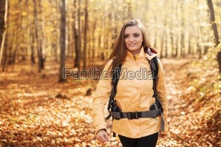 beautiful female hiker in forest