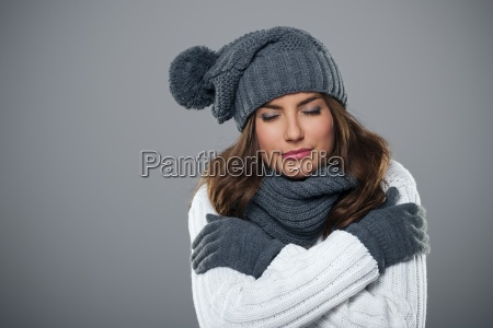 young woman shivering during the winter
