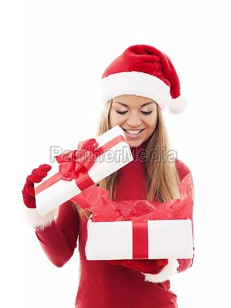beautiful woman opening christmas gift