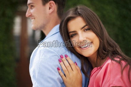 portrait of beautiful woman embracing her