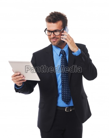 busy businessman working on tablet and