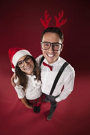 portrait of smiling nerd couple in