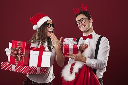 nerd couple exchanging christmas gifts