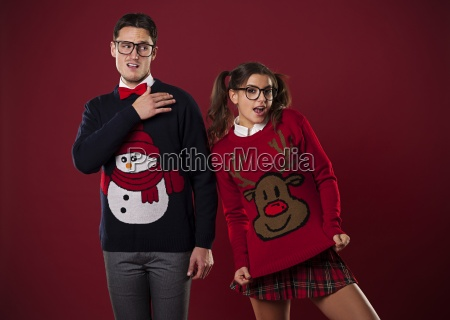 crazy nerd couple in funny sweaters
