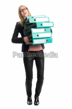 woman carrying stack of files