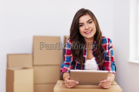 young woman using digital tablet during