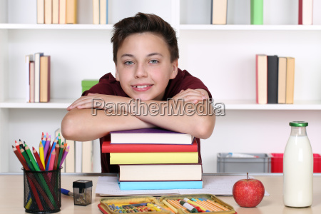boy and a stack of books