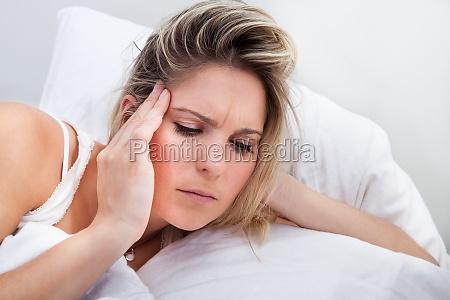 portrait of woman with headache