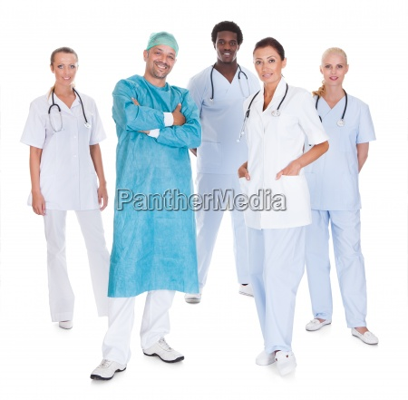 happy doctor in surgical gown with