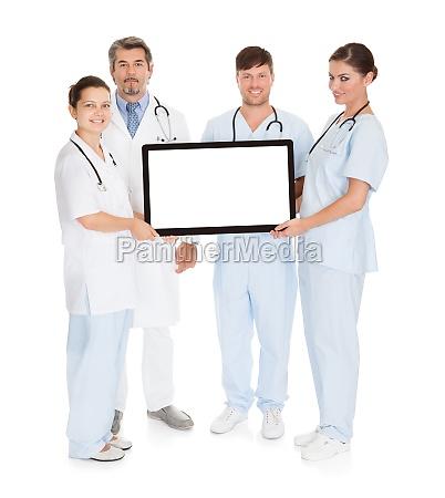 doctors holding computer