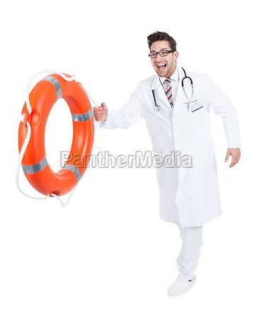 confident doctor holding lifebuoy