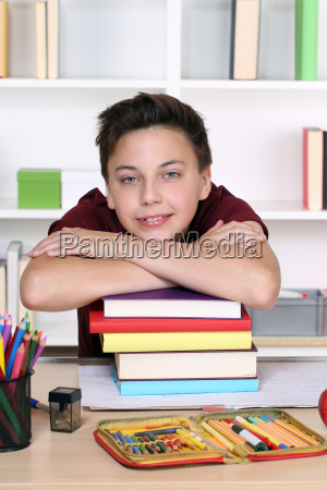 young student on a stack of