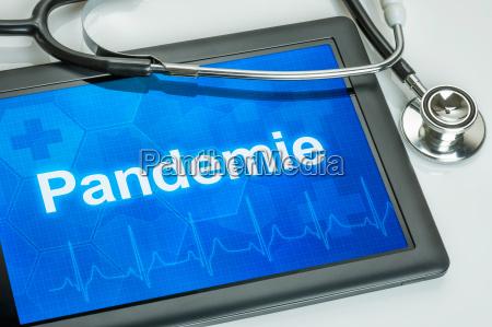 tableta con la pandemia de texto