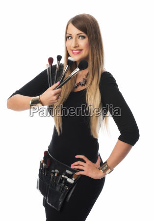beautician with several brush sticks