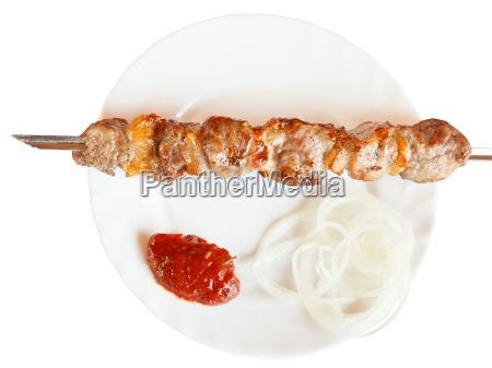 vista superior de brocheta con kebab