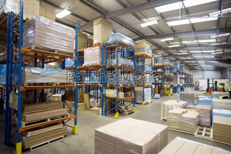 cardboard boxes and pallets in warehouse