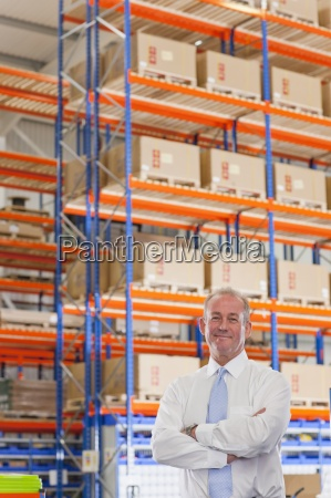 portrait of smiling supervisor with arms