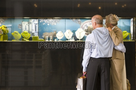 mature couple looking at display window