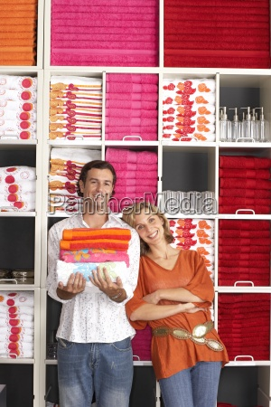 couple shopping in department store woman