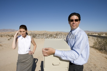 businessman and woman in desert man