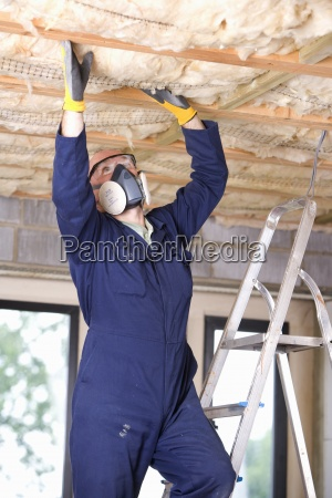 man wearing protective mask and installing