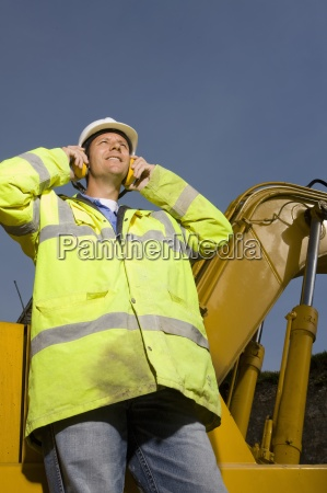 construction worker wearing ear protectors and