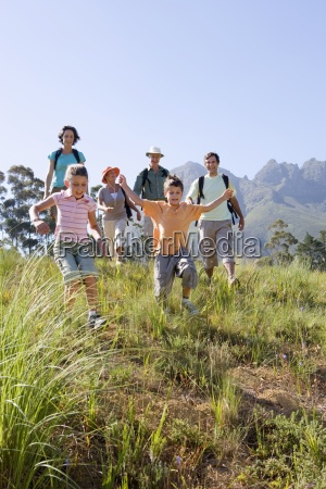 multi generational family hiking on mountain