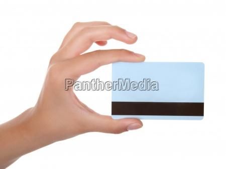 mano femenina con una tarjeta de
