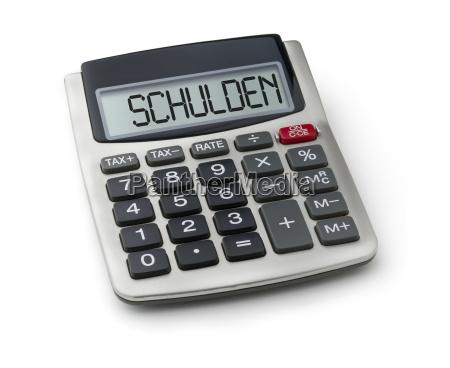 calculadora con la palabra deuda en