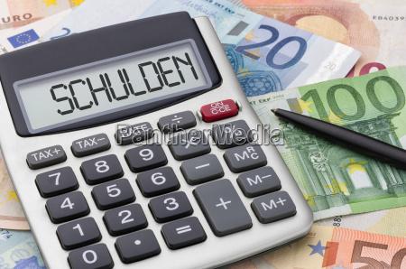 calculadora con billetes deuda